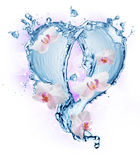 Heart from water splash with bubbles Royalty Free Stock Photography