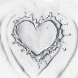 Heart from water splash with bubbles  on white Stock Photo