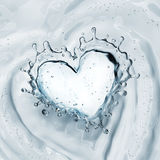 Heart from water splash with bubbles  on white Stock Image