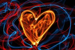 Heart of wave motion glowing lines on dark background Royalty Free Stock Images