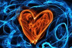 Heart of wave motion glowing lines on dark background Royalty Free Stock Image