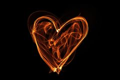Heart wave motion glowing lines on dark background Royalty Free Stock Image
