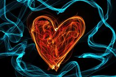 Heart of wave motion glowing lines on dark background Stock Images