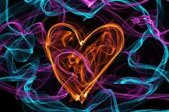 Heart of wave motion glowing lines on dark background Stock Image