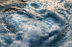 Heart of waves. Waves breaking in the sunset surf Stock Photos