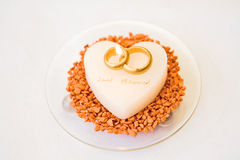 Heart Wedding Candle. White, heart shaped wedding candle with two intertwined gold rings and the words Just Married Royalty Free Stock Photos