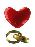 Heart with wedding rings on a white background. Royalty Free Stock Photo