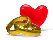 Heart and wedding rings on white background Royalty Free Stock Images