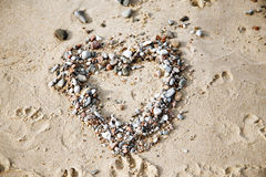 Heart on wet sand Royalty Free Stock Photography