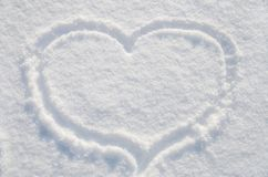 Heart on white, beautiful snow royalty free stock images