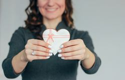 Heart white glazed gingerbread in woman hands, Valentine`s day royalty free stock photography