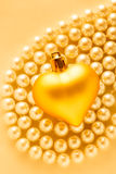 Heart on white pearl necklace Stock Images