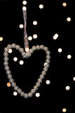 Heart of white pearls on black background, blurred Stock Photo