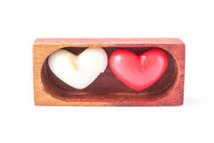 Heart white and red candles in a wooden box Stock Photo
