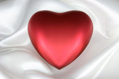 Heart on White Satin Stock Photography