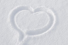 Heart on white snow Stock Photography