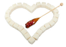 Heart from white sugar cubes and candy sugar Stock Photo