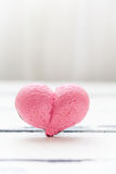 Pink heart shaped merengue for Valentines Day. Heart on white Valentines Day background with copy space stock photos