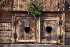 Heart windows. Particular of window in Slovenia Royalty Free Stock Photos