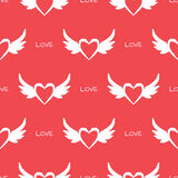 Heart with wings and the text Love. Repeating texture. Seamless pattern. Royalty Free Stock Photos