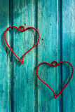 Heart of wire on a wooden vintage wood. Stock Photo