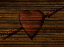 Heart in wood. Heart shape with arrow cut into wood Stock Image