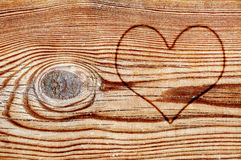 Heart on a wood board Stock Photos