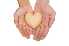 Heart of wood in two hands Royalty Free Stock Photography