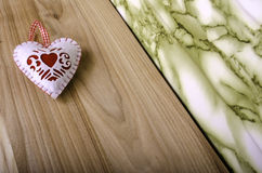 Heart on wooden background. Royalty Free Stock Photo