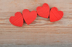 Heart on wooden background Stock Photos