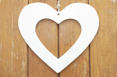 Heart on wooden background. Symbolic of love Royalty Free Stock Photography