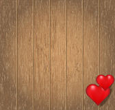 Heart on a wooden background. Two hearts on a brown wooden background Royalty Free Stock Photo