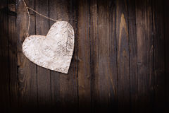 Heart on wooden background. Stock Photos