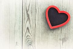 Heart on wooden background, valentine's  day decoration. Stock Photos