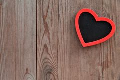 Heart on wooden background, valentine's  day decoration. Stock Photo