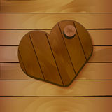 Heart on wooden background. Vector Stock Photos