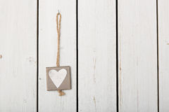 Heart on wooden background Stock Images