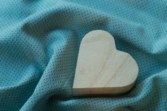 Heart  wooden box on cloth fabric Royalty Free Stock Images