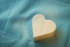 Heart  wooden box on cloth fabric Royalty Free Stock Photo