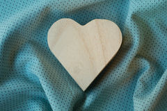 Heart  wooden box on cloth fabric Royalty Free Stock Photos
