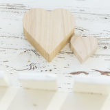 Heart wooden box on white wood Stock Photos