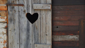 Heart on a wooden door in summer Royalty Free Stock Photos