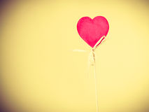 Heart on wooden stick. Royalty Free Stock Photos