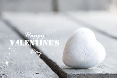 Heart on a wooden table and Happy Valentines Day text, blurred photo for background Stock Photography