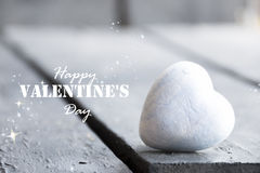 Heart on a wooden table and Happy Valentines Day text Stock Images