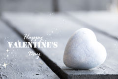 Heart on a wooden table and Happy Valentines Day text Royalty Free Stock Photo