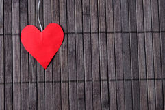 Heart on a wooden texture. Red heart on a wooden texture Royalty Free Stock Image