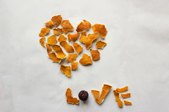 Heart and word Love made from orange peel. Composition for greeting card: Heart and word Love made from dry orange peel on a white background Royalty Free Stock Photo