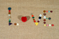 Heart and word love writing with sewing buttons Stock Image