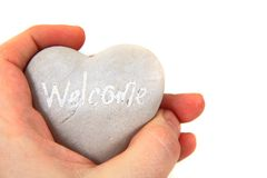 Heart with word welcome ni human hands Royalty Free Stock Images